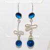Orecchini gemelli diversi con perle in agata sfumata